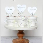 Whip up some elegant and inexpensive wedding place card holders out of mini flower pots!