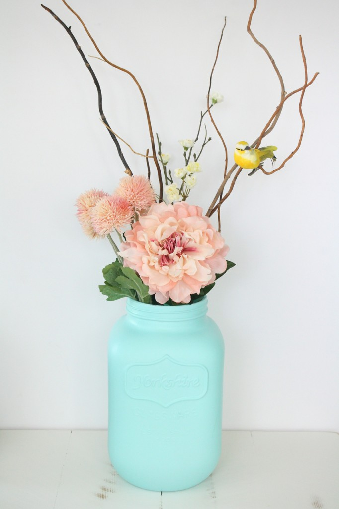 A giant spray painted mason jar makes a striking spring vase