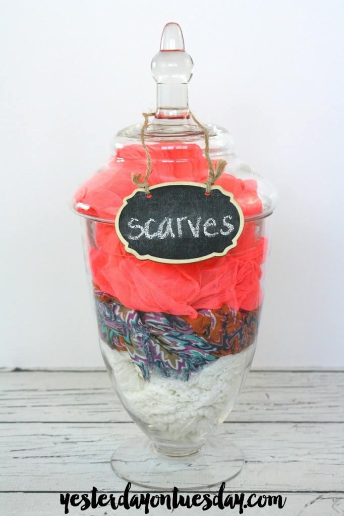 Stow scarves in a apothecary jar for easy access