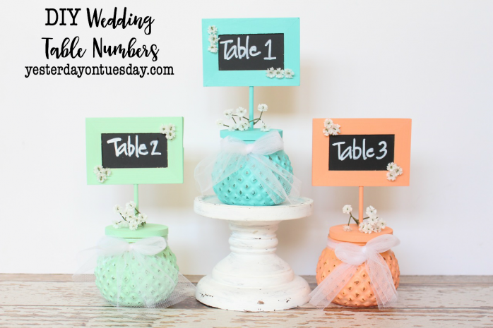 DIY Wedding Table Numbers: How to make rustic table numbers for a wedding, baby shower or any event. Beachy paint colors and a mini chalkboard make this a darling addition to any party.