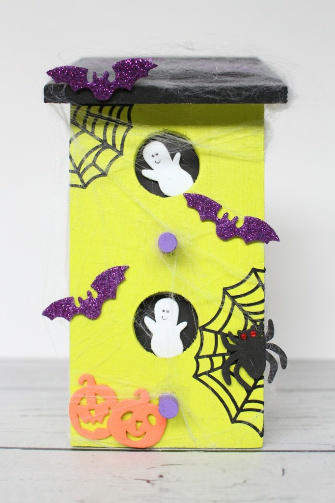 7 Spooky Halloween Kids Crafts including a Spider Web Doily Dream Catcher, Pom-Pom Crows, a Pinecone Witch, Haunted House and more.