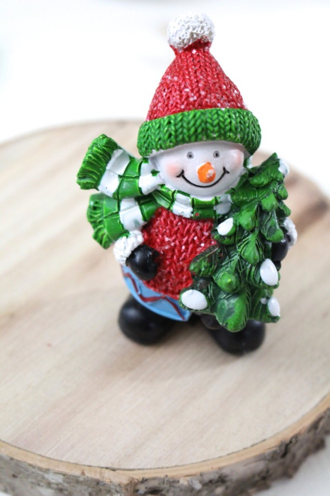 glueing-snowman-on-wood-slice