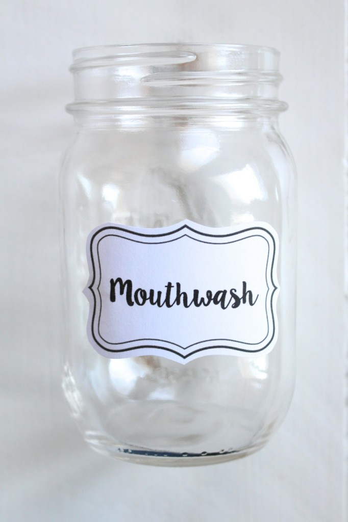 DIY Mason Jar Mouthwash Dispenser: No more ugly bottles!  Create a chic looking mouthwash dispenser out of a mason jar in minutes.