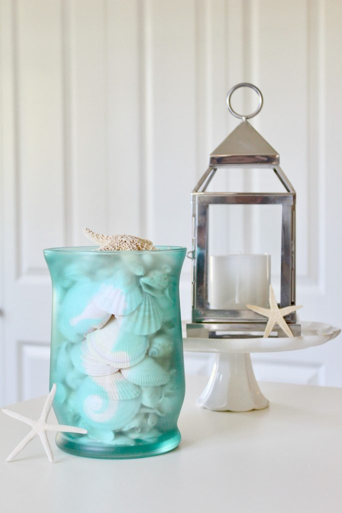 DIY Beachy Glass Hurricane: Tranform a plain glass hurricane into a beautiful piece of coastal decor.