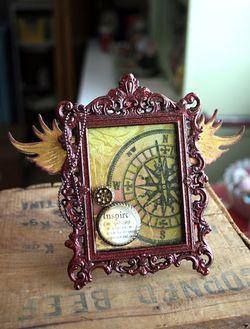 Metal frame tattered angels