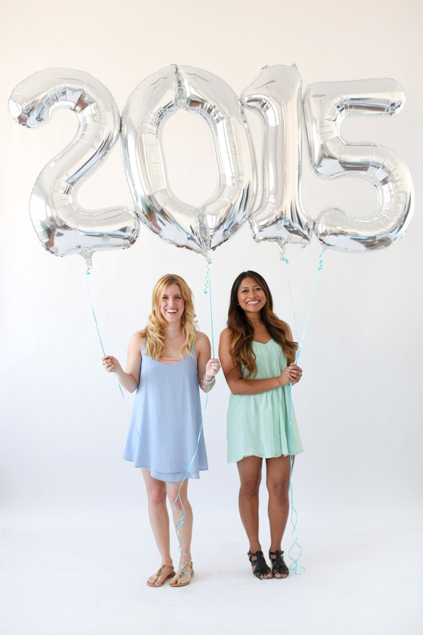 How to Throw a Great Graduation Party with fun ideas like using large mylar balloons for the year.