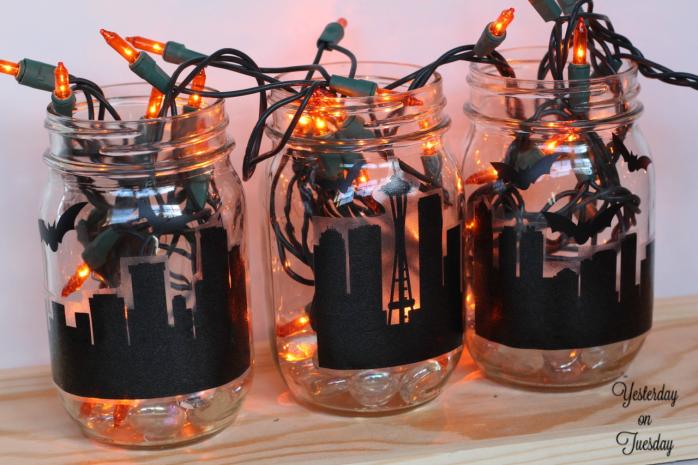 Spooky City Mason Jar Decor: How to transform plain mason jars into a spooky city scene for Halloween.