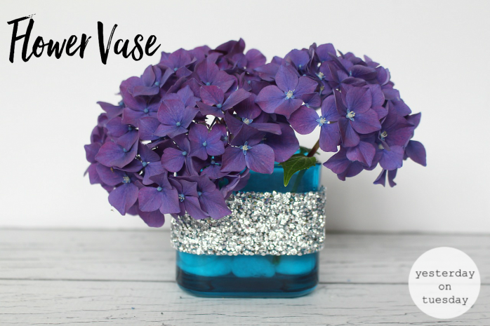 7 Gorgeous Ways to Reuse Glass Candle Holders including a beachy display, flower vase, place to corral glasses, desk set and more!