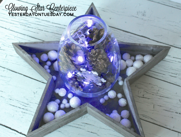 DIY Glowing Star Centerpiece with pinecones