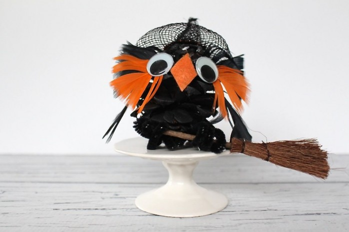 7 Spooky Halloween Kids Crafts including a Spider Web Doily Dream Catcher, Pom-Pom Crows, a Pinecone Witch and more