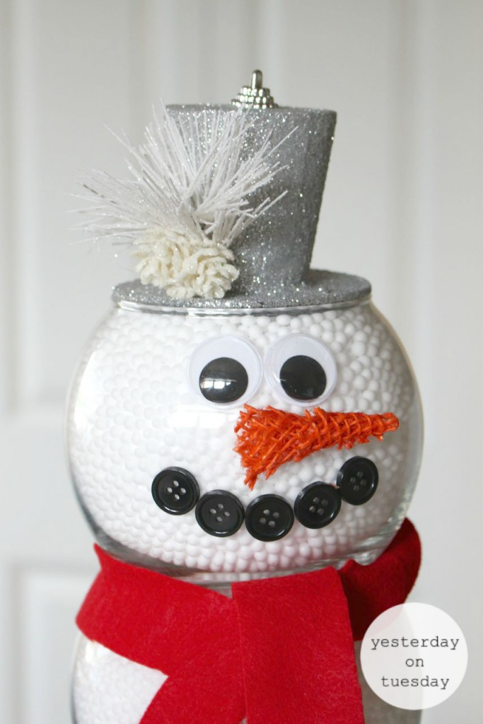 Dollar Store Fishbowl Snowman: Make a darling snowman for holiday decorating, using budget friendly supplies from the dollar store. A charming and easy way to add the spirit of the holidays to your home.