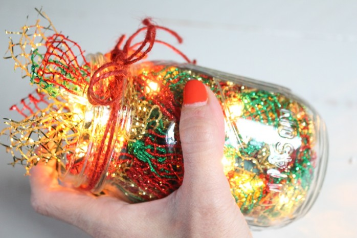 Lighted Christmas Garland: How to transform a plain string of lights and some ribbon from the dollar store into lush and festive holiday decor.