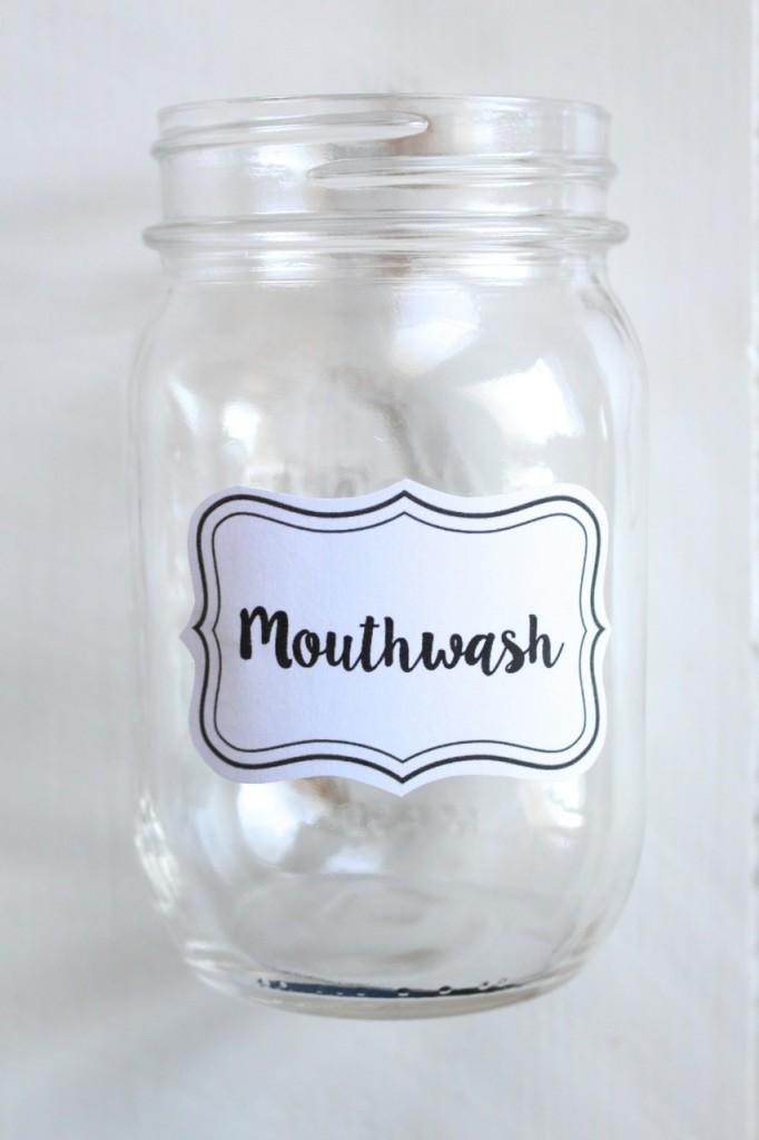 DIY Mason Jar Mouthwash Dispenser: No more ugly bottles!  Create a chic looking mouthwash dispenser out of a mason jar in minutes.