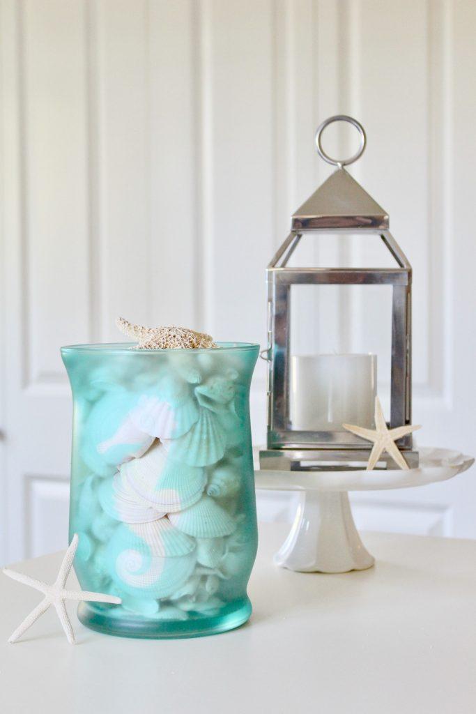 DIY Beachy Glass Hurricane: Tranform a plain glass hurricane into a beautiful piece of coastal decor.
